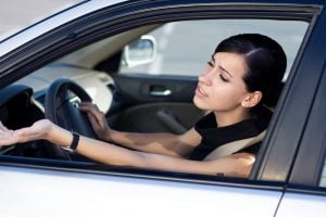 Woman driver is angry stucking in traffic jam